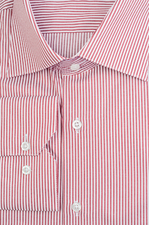 cuff link: Classic elegant mans striped red shirt with buttons Stock Photo