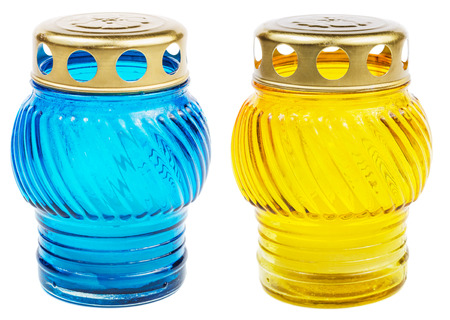 votive: Blue and yellow votive candles isolated on white background with clipping path. Cemetery candles.