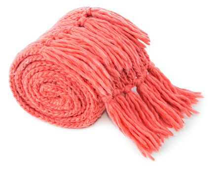 Rolled red textile scarf isolated on white background Stock Photo