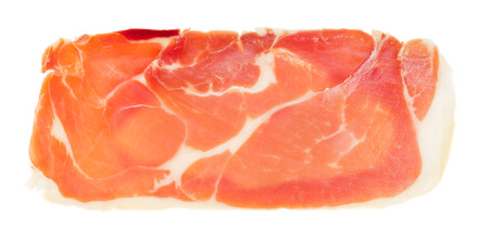 Slice of raw italian prosciutto crudo, jamon. Isolated on white background.