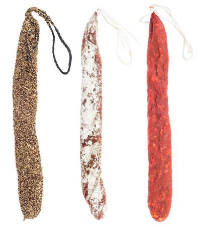 Variety of vertically arranged salami sausages isolated on white background. Swiss style peperoni or salami, parsley sausage.