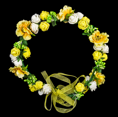 Yellow flower wreath isolated on black background Stock Photo