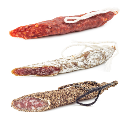 Salami sausages isolated on white background. Swiss style peperoni or salami, parsley sausage.
