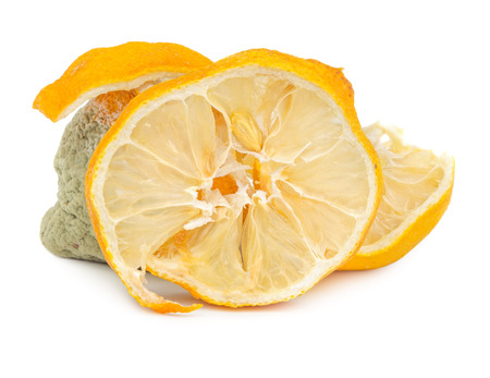 Rotten and dry lemon isolated on white background Stock Photo