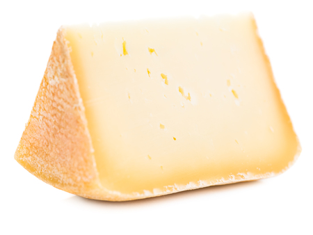 Piece of natural hard cheese isolated on white
