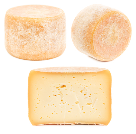 Head (Wheel) of natural hard cheese isolated on white background.