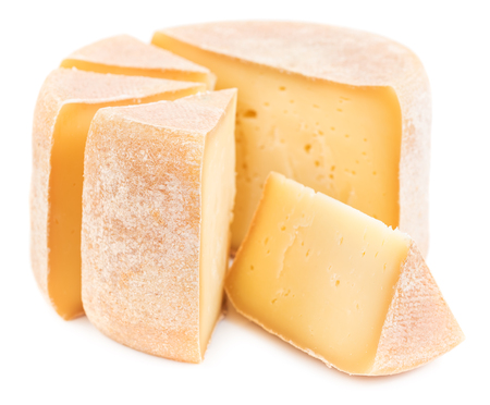 Pieces of natural hard cheese isolated on white background.