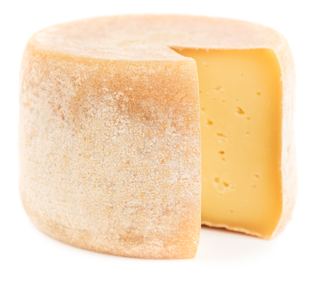 Cut out of natural hard cheese isolated on white background.