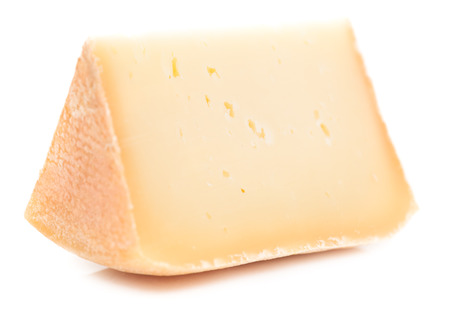 Single piece of natural hard cheese isolated on white background.