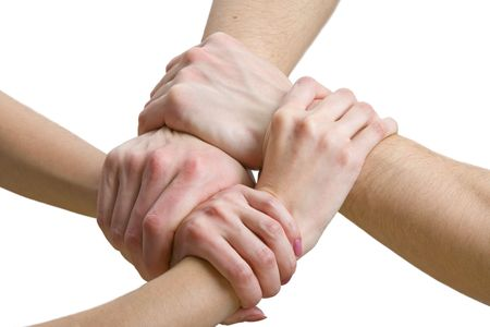 four hands touching each other, close-up