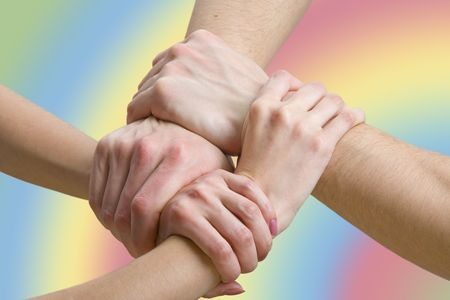 cohesion: four hands touching each other, close-up