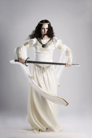 traditional weapon: A lady with sword in traditional medieval dress