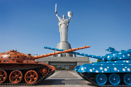 Two tanks against the background of the monument in Kiev