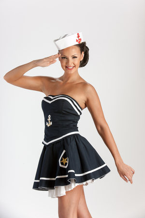 sailor girl: Sexy girl with stylish make-up dressed as sailor, over white background