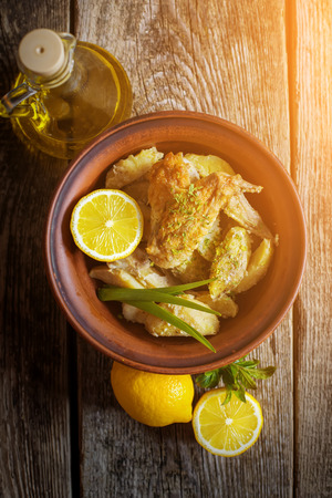 roasted chicken on a plate on a wooden background photo