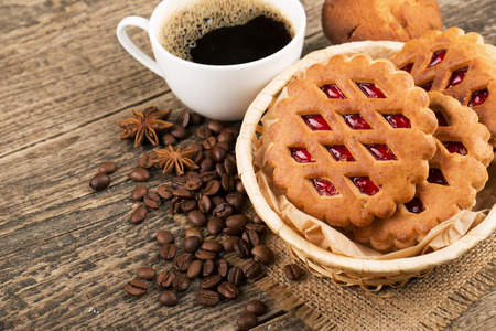 coffee and cookies on wood background photo