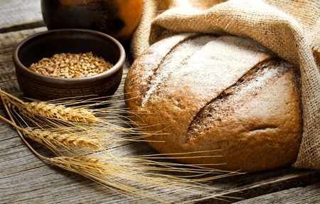 bread: fresh bread and wheat on the wooden