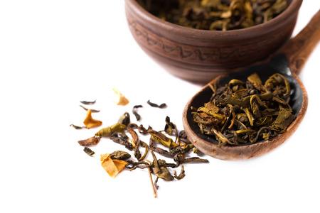pekoe: Spoon of dried black tea leaves on white background