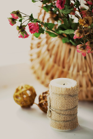 spliced: candle on background basket with roses
