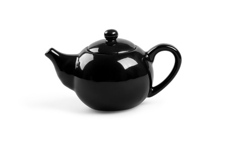 Black tea pot isolated on white background photo