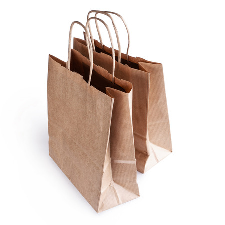 two paper bags isolated on white background photo