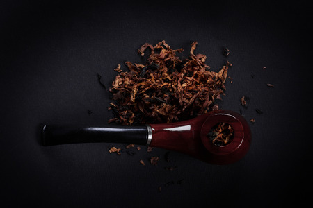 classic contrast: pipe and tobacco on a black background
