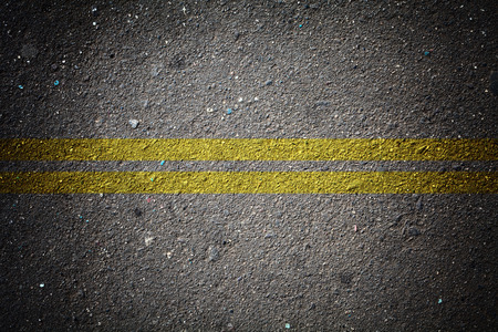wallpaper of dry asphalt texture with double solid line photo