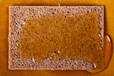 smeared: smeared with honey on the loaf