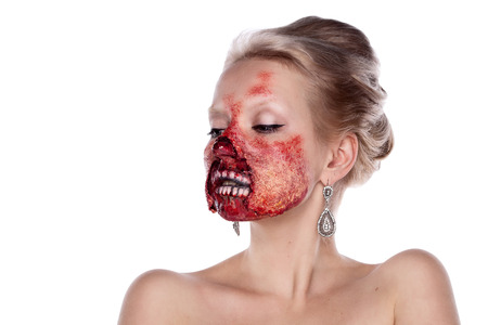 Portrait of blond bloody zombies in a festive makeup, isolated on white background photo