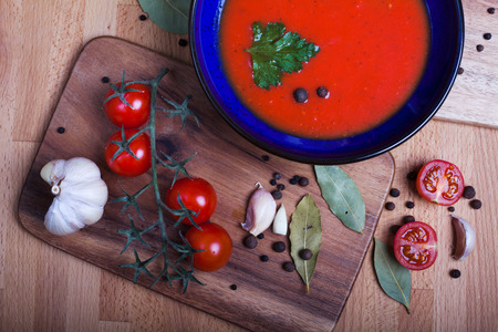 tomato soup with ingredients for cooking photo