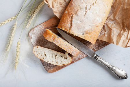 artisanal: sliced fresh white bread with spices and browned crust