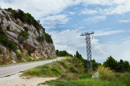 power line in the mountains near the road in Croatia Imagens