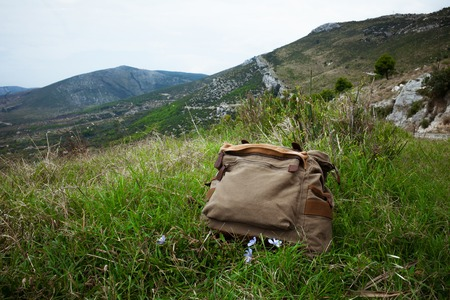 backpack on the grass at the top of the mountain in Croatia Stock Photo