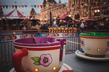 Childrens carousel at the New Years fair in Moscow, winter 2018