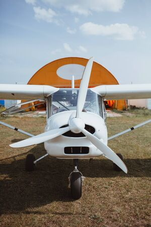 a small white plane stands on the ground. front view Reklamní fotografie