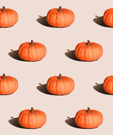 pastel seamless background, pumpkin with hard light in pop art style