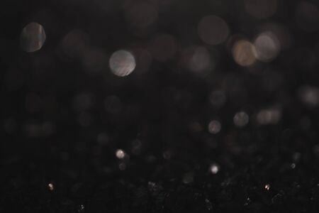 Monochrome vintage abstract background with bokeh defocused lights. 写真素材