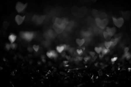 Black and white vintage abstract background with bokeh defocused lights. Heart shape 写真素材