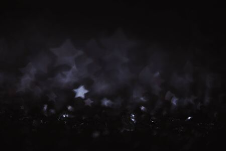 Monochrome vintage abstract background with bokeh defocused lights. Star shape 写真素材