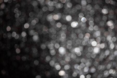 Monochrome abstract background with medium bokeh defocused lights. 写真素材