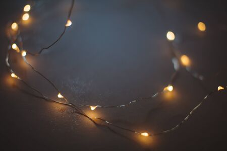 Vintage wallpaper garland with lights, focus on the foreground, place for text