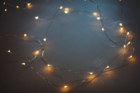 Vintage wallpaper garland with lights in heart shape boken, focus on the foreground, place for text 写真素材