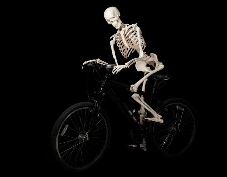 halloween skeleton: A skeleton rides a bicycle from nowhere  Stock Photo