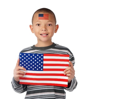 A proud american boy displays an american flag on his forehead and in his hands  Stock Photo