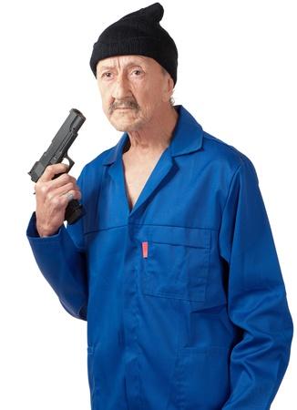 contemplates: A senior man contemplates suicide whilst holding a handgun