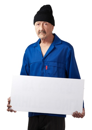 A serious senior worker displays a blank poster. photo