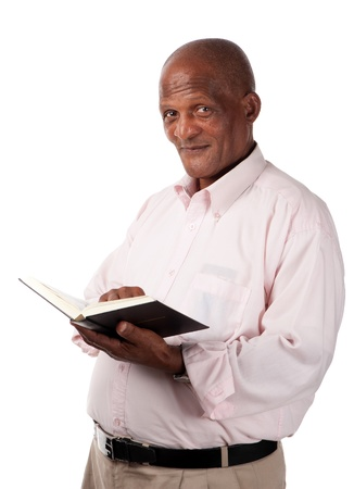 A senior person holds a holy or text book in his hands  Stock Photo