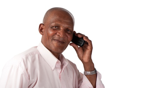 A happy senior man communicates on his cellular phone  photo