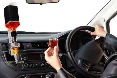 A woman sits behing a steering-wheel of a car specially converted for her to drink whlist driving. Stock Photo - 16854574