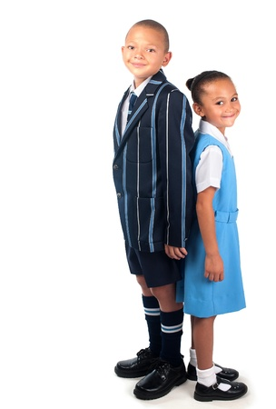 A happy brother and sister in school uniform appear ready to go to school